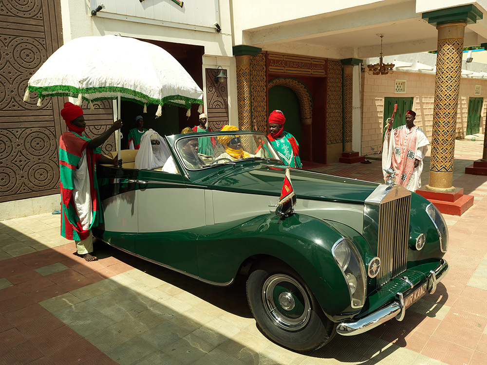 Photo by George Osodi on Nigerian Royalties combining traditional king like regalia with contemporary touches like convertibles and spiffy shades at http://tiny.cc/7olhhx
